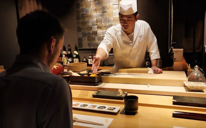 sitting_at_the_counter_of_sushi_fukuju